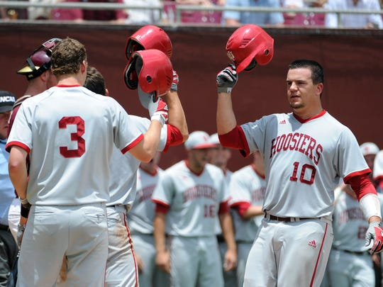IU catcher Kyle Schwarber (10) celebrates with teammates after a home run in the game against the Florida State Seminoles during the Tallahassee super regional of the 2013 NCAA baseball tournament at Dick Howser Stadium