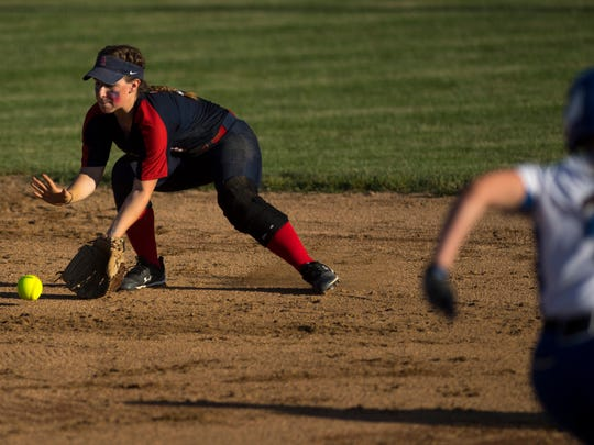 Heritage Hills' Mallory Garrison fields a Memorial grounder to get the force out at second base during the 3A IHSAA Boonville Sectional Thursday evening.