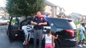 Springettsbury Township Police Officer Cory Landis with neighborhood youth on a summer evening.