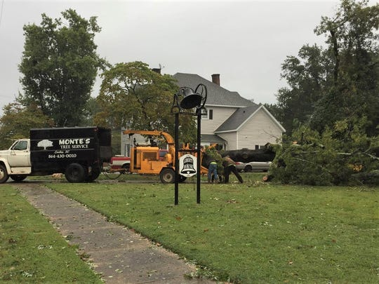 Pickens County News reader Chris Carroll submitted several pictures of day-after storm damage around Liberty, including this shot of workers busy outside the Liberty House Bed and Breakfast.
