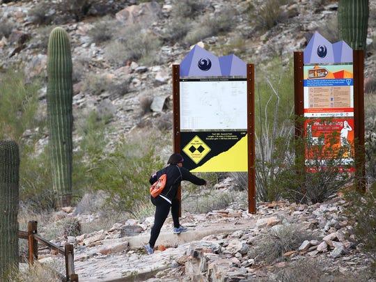 A hiker starts her climb from the Summit trailhead at Piestewa Peak in the Phoenix Mountain Preserve on Jan. 3, 2017 in Phoenix.