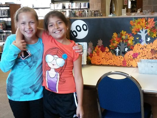 Manville: Library holds coloring station--PHOTO