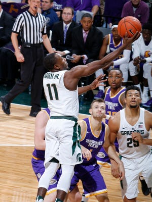 Michigan State's Tum Tum Nairn scores against Tennessee Tech during the first half Saturday, Dec. 10, 2016 in East Lansing.