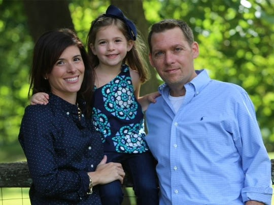 Anthony Senerchia Jr. with his wife Jeanette, and their daughter Taya.