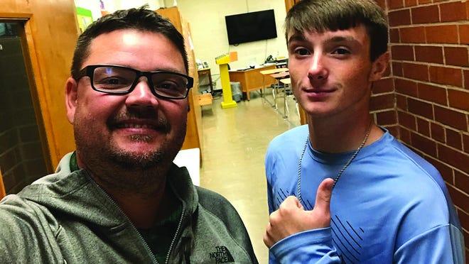 USD 382 Pratt JAG-K instructor Shaphan Staats and student Camden Nickelson work on job-skills tasks earlier during the 2019-2020 school year.
