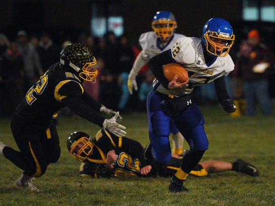 Castlewood's Brandon Benike runs the ball down the