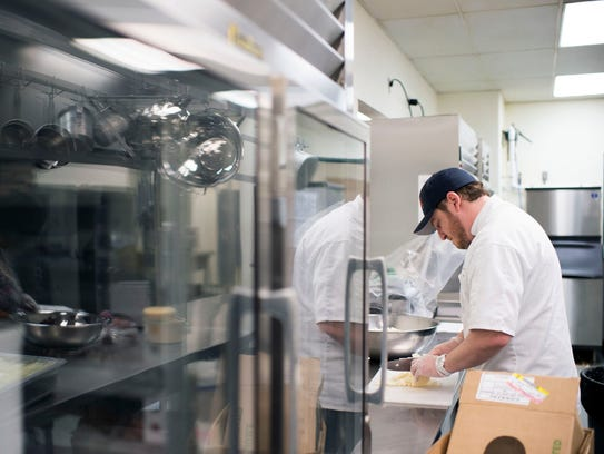 SoDel Concepts corporate chef Ronnie Burkle chops jicama