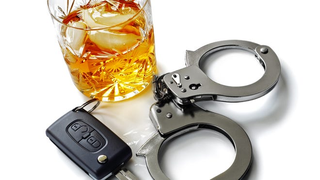 Whiskey with car keys and handcuffs