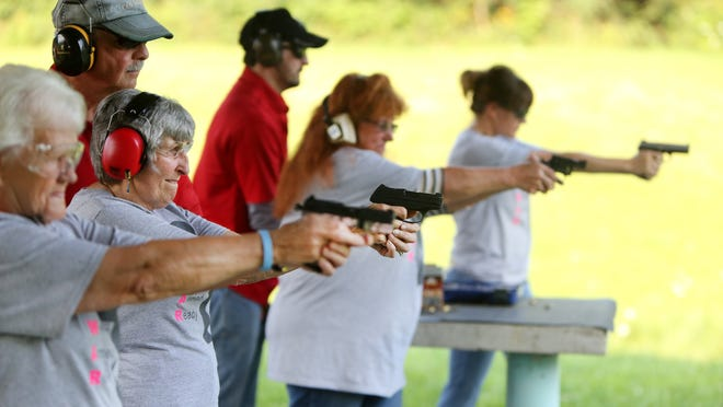Members of the Women Armed and Ready gun club take target practice at the Laughery Valley Fish and Game Shooting Range in Versailles, Indiana. Maag is a certified NRA instructor and supports education as a means to gun safety.