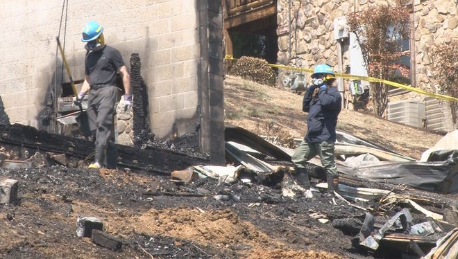 A group of 25 people from Indiana were staying in an East Tennessee cabin when it caught fire Saturday morning, April 12, 2014, leaving one man dead and a child missing.