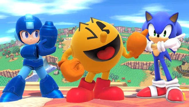 """Capcom's Mega Man (left) and Sega's Sonic The Hedgehog (right) will be joined by Namco's Pac-Man in Nintendo's upcoming """"Super Smash Bros."""" on the Wii U and 3DS"""