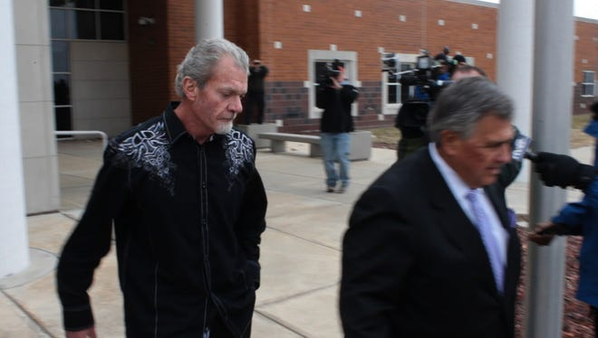 Jim Irsay, owner of the Indianapolis Colts, exits a Noblesville detention facility on the day after he was arrested on four felony counts in Carmel, March 17, 2014.
