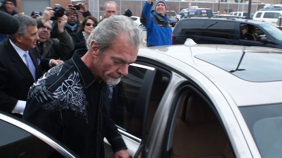 Colts owner Jim Irsay exits a Noblesville detention facility Monday on the day after he was arrested on four felony counts in Carmel.