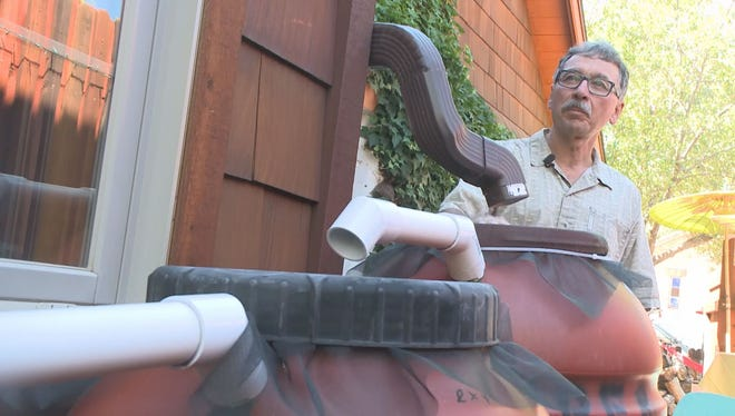 Gardner Ted Melis with his simple rainwater-reclamation system.