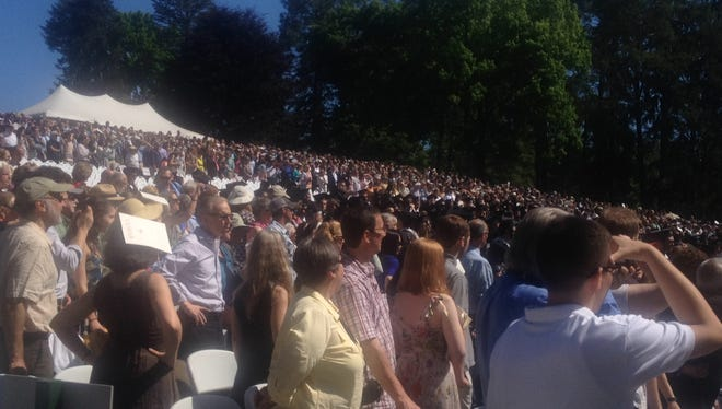 Loved ones watch Vassar College's 150th graduating class take their seats before their commencement ceremony.