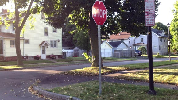 Stop sign stands sentry at a neighborhood intersection