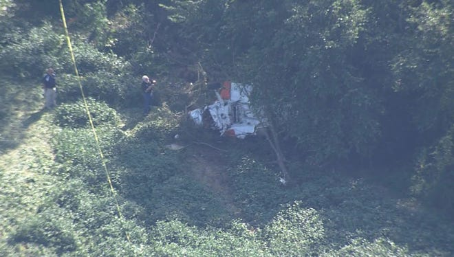 Aerial view of the wreckage of a Cessna 188 in Hardeman County