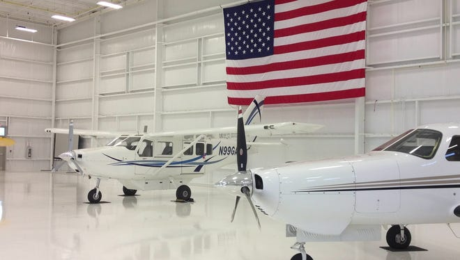 The former HondaJet hangar is now occupied by a GA8 Airvan, left, and a single-engine Piper model.
