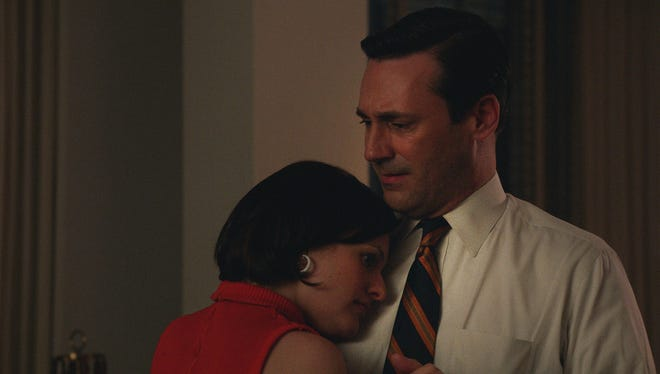 """Elisabeth Moss as Peggy Olson and Jon Hamm as Don Draper in a scene from """"Mad Men"""" Season 7."""