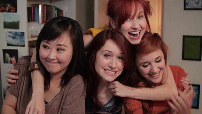 Charlotte Lu (Julia Cho), from left, Lizzie Bennet (Ashley Clements), Lydia Bennet (Mary Kate Wiles) and Jane Bennet (Laura Spencer) vlog about their lives in an episode of 'The Lizzie Bennet Diaries.'