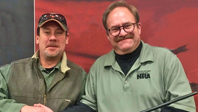 Steve Kumbier of Fond du Lac, left, was the winner of the Fond du Lac Area Friends of NRA raffle, drawn Jan. 24 at the Fond du Lac County Fairgrounds during the Central WI Gun Show. Kumbier won a Kimber 84M Classic .308 WIN Rifle and a Kimber Pro Carry II .45 Pistol (not shown). He is pictured with Cary McQuitty, of the Friends of NRA.