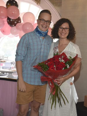 Deb Cabral's daughter Shannon and her fiancé Ross celebrate at Shannon's Bridal Shower on Aug. 8.