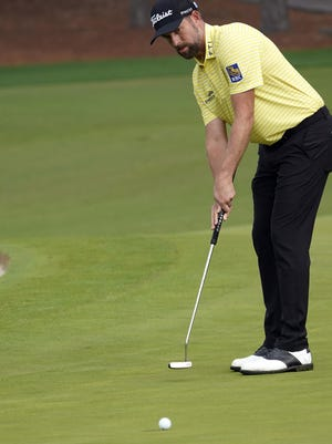 Webb Simpson putts on No. 2 during the final round of the Masters Tournament on Sunday.