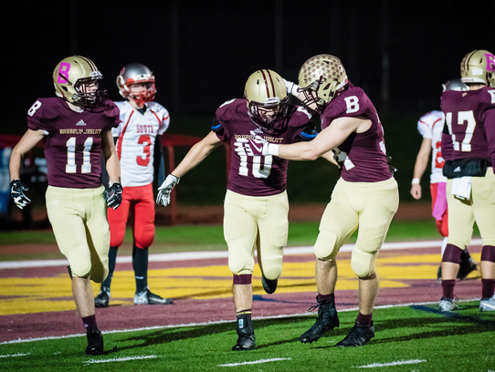 Noah Delumpa (10) is congratulated by Dillon Howell