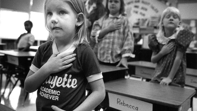 Learning the Pledge of Allegiance remains a first-day ritual in may Topeka public schools. First-grader Jolene Burdette, 6, attended the first day of school Sept. 3, 1986, in teacher Mary Dalton's class at Lafayette Elementary School, 420 California.