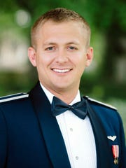 This undated photo provided by the U.S. Air Force shows Capt. Kenneth Dalga, from Goldsboro, N.C. Dalga was one of three service members killed Tuesday, March 14, 2017, in the crash of a reconnaissance and surveillance plane during a training flight in eastern New Mexico.