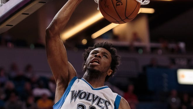 Andrew Wiggins dunks home two of his career-high 47 points.