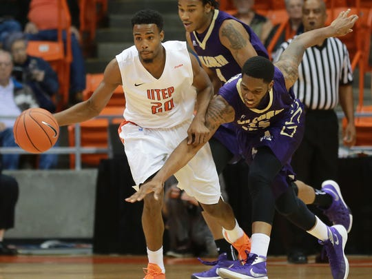 UTEP'S Earvin Morris, left, fends off a steal attempt by Alcorn States' Patick Onwenu during the first half Sunday Nov. 22, 2015.