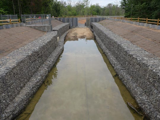 The raceway gradually begins to fill with water, just
