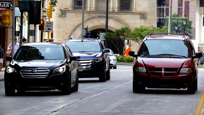 Motorists drive through downtown Milwaukee.