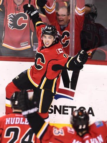 Calgary Flames left wing Johnny Gaudreau (13) celebrates
