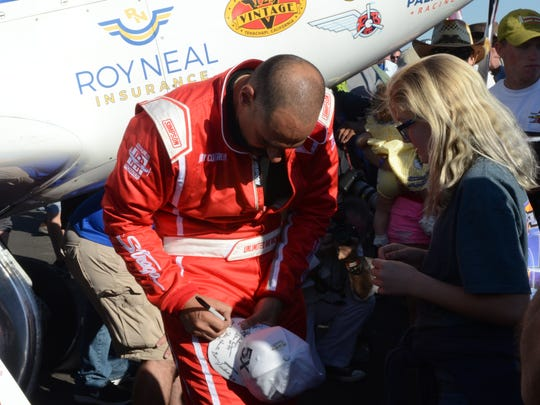 Jay Consalvi signs an autograph after taking first place in the Unlimited Gold Championship on Sunday.