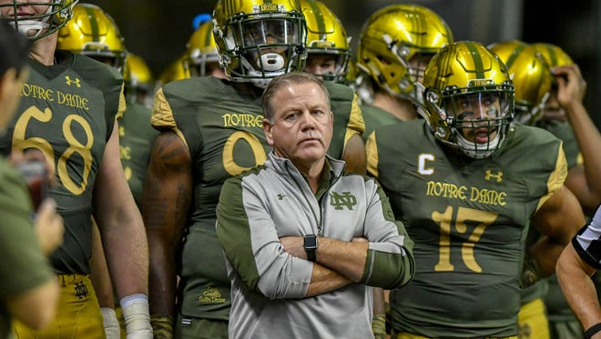 Nov 12, 2016; San Antonio, TX, USA; Notre Dame Fighting Irish head coach Brian Kelly waits to take the field for the game against the Army Black Knights at the Alamodome. Mandatory Credit: Matt Cashore-USA TODAY Sports