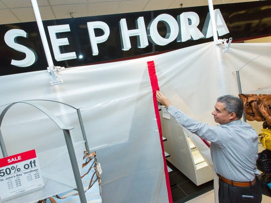 JCPenney general manager Pete Saenz opens the tarp covering the Sephora store on Tuesday May 3, 2016. The makeup retail store, which is located in the JCPenney of Mesilla Valley Mall, is schedule to open on June 17th.