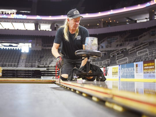 Union stage hand Tom Odea pins the hardwood floors