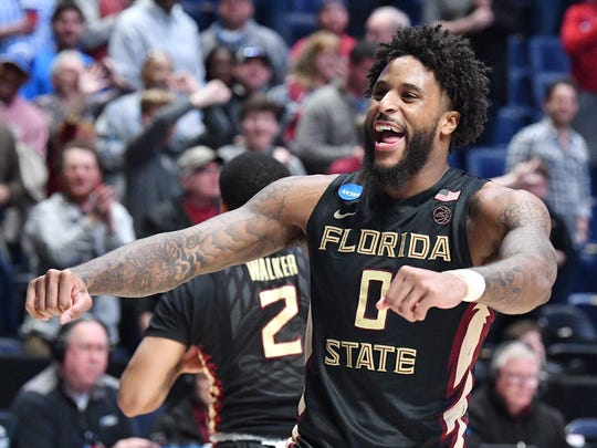 Florida State forward Phil Cofer (0) celebrates the win over Xavier in the second round of the NCAA Division I Men's Basketball Championship at Bridgestone Arena Sunday, March 18, 2018 in Nashville, Tenn.