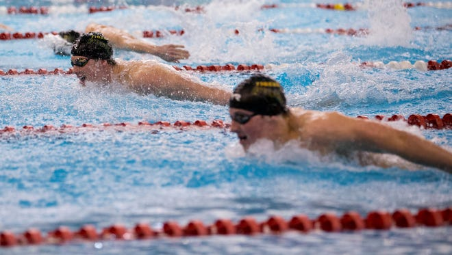 Members of the St. Xavier swim team compete in the Boys 200 yard Individual Medley Championship Final during the KHSAA Swimming Regional Championship.