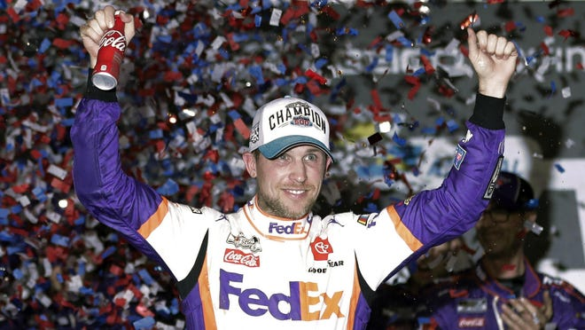 Denny Hamlin, seen here celebrating his win at the Daytona 500 in February, won NASCAR's virtual race at Homestead Sunday.