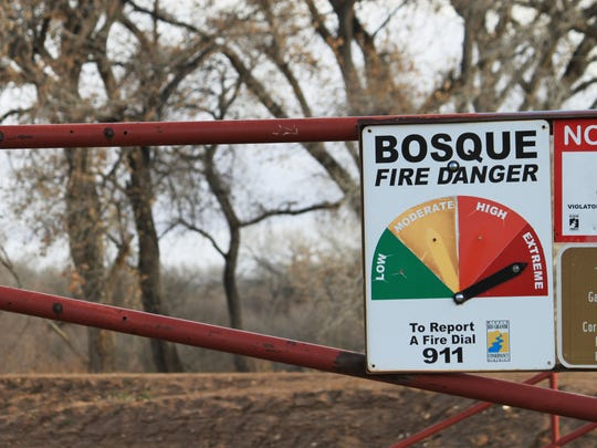 A fire danger sign indicates conditions are extreme in the wooded areas along the Rio Grande on the northern edge of Albuquerque, N.M., on Thursday, Feb. 22, 2018. Some land managers in New Mexico are beginning to impose fire restrictions as officials with the Farm Service Agency say many ranchers are scrambling to buy up alfalfa reserves to supplement feed for their livestock as drought conditions are expected to intensify across the state.