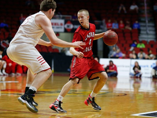 Cedar Falls sophomore A.J. Green moves the ball up
