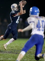 Little Chute's Jacob Lillge makes a first down catch late in the fourth quarter against Wrightstown during a game last season in Little Chute.