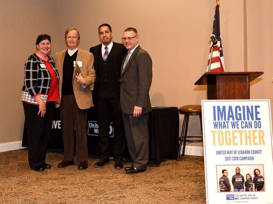 (From left) Rene Numer, United Way Board of Directors President; Bob Hoffman, 2017-2018 Campaign Chair; Kenny Montijo, United Way CEO; and Colonel Doug Etter. Hoffman accepted the inaugural Robert P. Hoffman Volunteer Excellence Award at the United Way of Lebanon's Campaign Celebration Feb. 1, 2018.