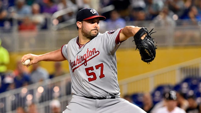 Washington Nationals starting pitcher Tanner Roark (57) throws against the Miami Marlins during the first inning at Marlins Park.