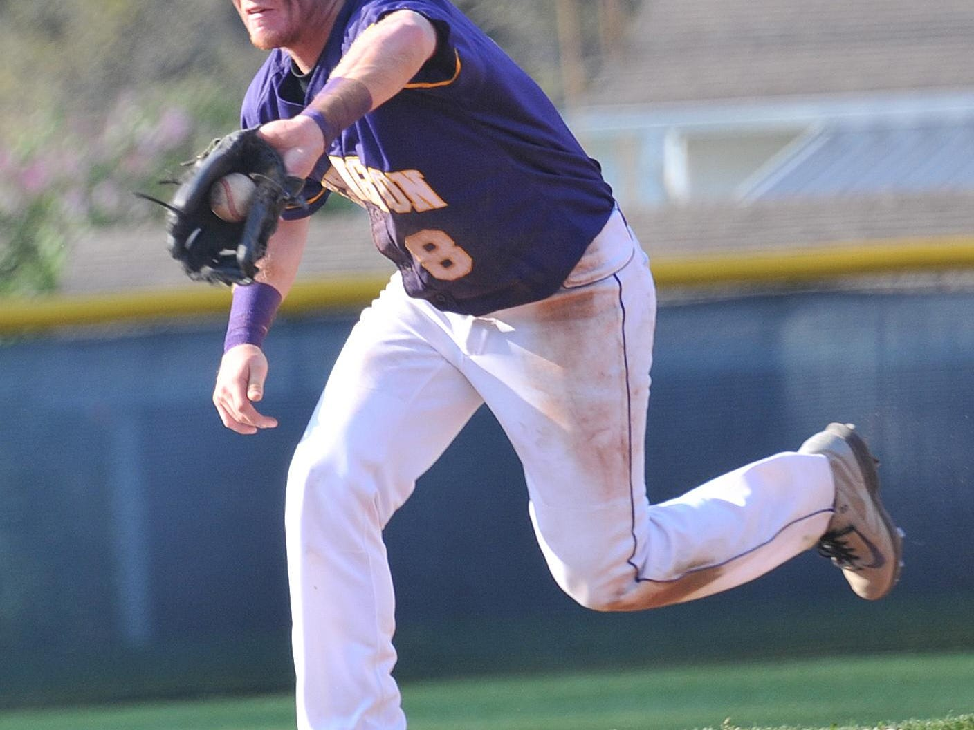 Lexington's Evan Lee fields a ground ball in an Ohio Cardinal Conference win at Madison. A shortstop and a pitcher, Lee repeated at News Journal Baseball Player of the Year.
