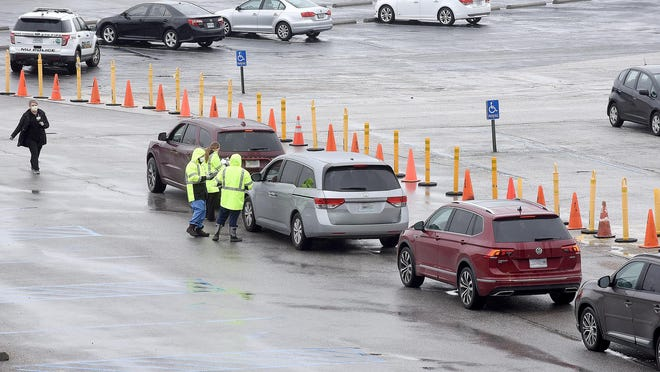 Cars line up in March for COVID-19 tests in the Hearnes Center parking lot. MU Health Care announced Friday that it would suspend operations at the site, consolidating drive-through testing at its Mizzou North campus, 115 Business Loop 70 W.
