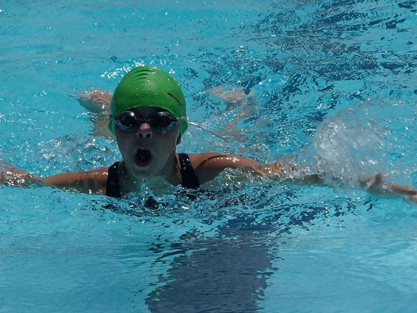 Mountain Home's Landra Ballard competes in a butterfly event in a recent meet at Mountain View. The Hurricanes won the South Wind meet, hosted by Stone County.